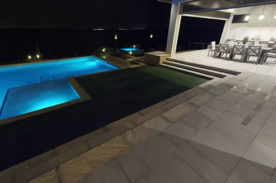 SA Promenade Step Treads and Platinum and Promenade Pool Coping at night