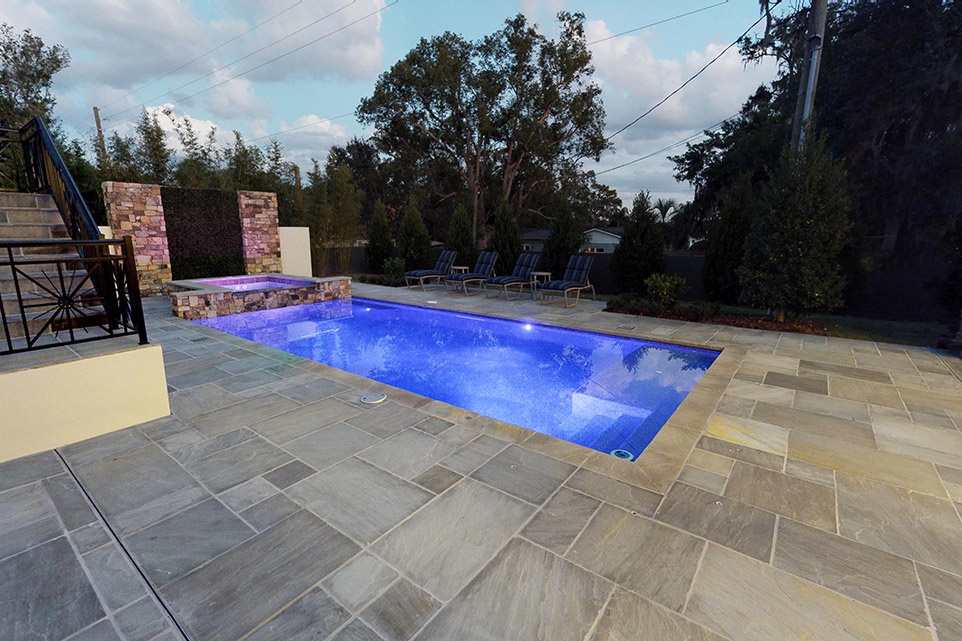 tnar promenade classicstone with Promenade chiseled edge pool coping pool deck in evening